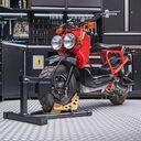 Inrijklem voor scooters met rode Honda scooter