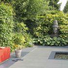 Excluton Optimum Fuego Silver in tuin met veel groen