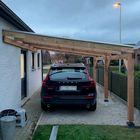 Carport geplaatst op betonpoeren
