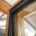 Glazen schuifwand 5-delig breedte 482 cm met onder-, boven-, en zijprofiel 228,6 cm