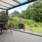 tuinkamer met glaswanden schuifsysteem
