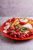 Le Creuset ontbijtbord oranje-rood Ø 22 cm sfeer