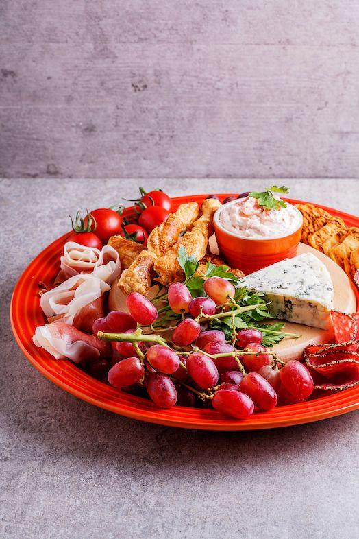 Le Creuset dinerbord oranje-rood Ø 27 cm sfeer